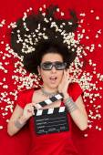 Surprised Girl with 3D Cinema Glasses,  Popcorn Director Clapboard — Stock Photo