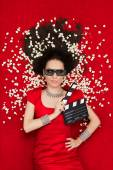 Cool Girl with 3D Cinema Glasses, Popcorn and Director Clapboard — Stock Photo