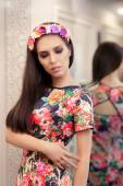 Beautiful Girl Trying on Floral Dress — Stock Photo