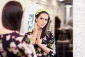 Beautiful Girl Looking in the Mirror and Trying on Floral Dress — Stock Photo
