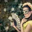 Beautiful Woman with Floral Wreath, Mask and Fan — Stock Photo #78482926
