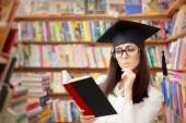Curious School Student Reading a Book in a Library — Stock Photo