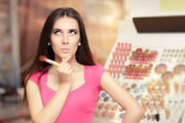 Surprised Woman Holding a Make-up Brush — Stock Photo