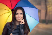 Happpy Autumn Woman Holding Rainbow Umbrella out in the Rain — Stock Photo