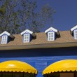 Yellow awning and blue window shop — Stock Photo #63879945
