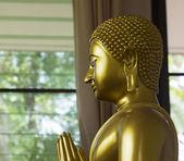Left side of golden monk statue — Stock Photo