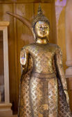 Golden buddha statue with the forbidding hand acting — Stock Photo
