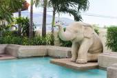 Elephant statue spouting water — Stock Photo