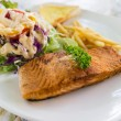 Grilled salmon steak with french fried and vegetable salad — Stock Photo #71604463