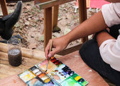 Artista com pincel e paleta — Fotografia Stock