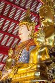 Asian angel and golden buddha statue — Stock Photo