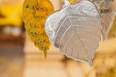 Silver metal sheet in bo leaf shape — Stock Photo