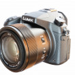Постер, плакат: Panasonic Lumix DMC FZ1000 bridge digital camera isolated on wh