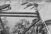 Old rusty black bicycle — Stock Photo