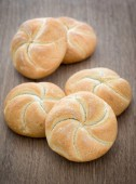 Homemade fresh bread buns  on old wooden table, selective focus — Stock Photo