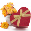 Yellow with red roses and box gift — Stock Photo #53596709