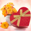 Yellow with red roses and box gift — Stock Photo #53596829