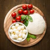 Ingredients for pizza margherita on wooden plate top view — Foto de Stock