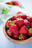 Wooden bowl filled with fresh ripe strawberries — Stock Photo