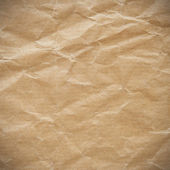 Crumpled eco paper background vignette — Stock Photo