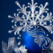 Blue and silver christmas ornaments on dark blue xmas background with space for text — Stock Photo #55881521