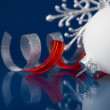 White, silver and red christmas ornaments on dark blue xmas background — Stock Photo #55881899