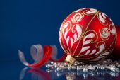 Red and silver christmas ornaments on dark blue xmas background with space for text — Stock fotografie