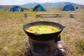 Preparation of soup on open fire — Stock Photo