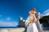 Happy bride and bridegroom are hugging — Stock Photo