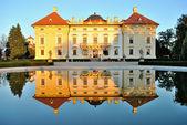 Slavkov castle reflected in water — Stock Photo