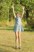 The happyl girl is dancing in a garden. — Stock Photo