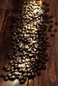 Coffee beans on old table — Stock Photo