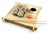 Teriyaki chicken sushi on rustic bamboo tray with soy sauce and  — Photo