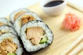 Closeup of teriyaki chicken sushi rolls with cucumber, chopstick — Photo