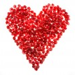 Love heart shaped pomegranate seeds — Stock Photo #56311763