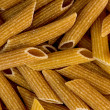 Macro closeup background texture of whole wheat rigatoni pasta  — 图库照片 #57875811