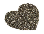 Macro perspective of natural chia seeds in heart shape — Stock Photo