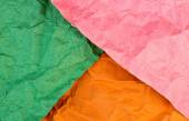 Multicolored background texture of creased recycled papers — Stock Photo