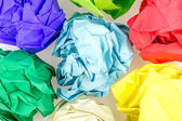 Multicolored crumpled balls of paper — Stock Photo
