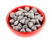 Bowl filled with chocolate chips isolated on white — Stock Photo