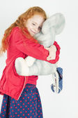 Happy Little Girl with Red Hair Playing with Big Toy — Stock Photo