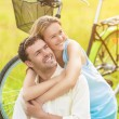Positive Smiling Happy Couple Sitting Together Outdoors With Bik — Stock Photo #54028295