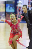 Minsk-Belarus, October 4,2014: Unidentified Professional dance couple performs Adult Latin-American program on World Open Minsk-2014 WDSF Championship in October 4, 2014 in Minsk — Stock Photo