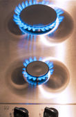 Two Gas Burners with Regulator Valves on Stove Surface — Stock Photo