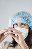 Closeup of the Face of Female Caucasian Staff in Facial Mask Wit — Stock Photo