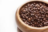 Heap of Roasted Aromatic Coffee Beans Placed in Wooden Bowl over — Stock Photo