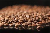 Heap of Aromatic Roasted Coffee Beans Placed over Black Backgrou — Stock Photo