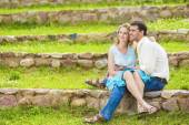 Two Caucasian Sweethearts Together Outdoors. Reading e-Book and — Stockfoto
