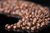 Roasted Coffee Beans Over Black Background — Stock Photo