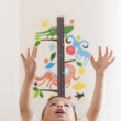 Portrait of Little Caucasian Boy Using Wall Ruler for Making Hei — Stock Photo #64248469